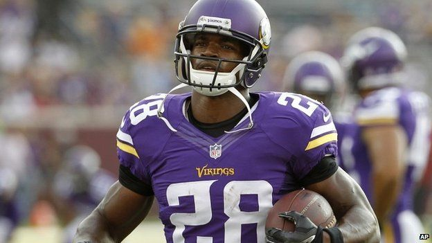 Minnesota Vikings player Adrian Peterson warms up before a game against the Arizona Cardinals in Minneapolis - 16 August 2014