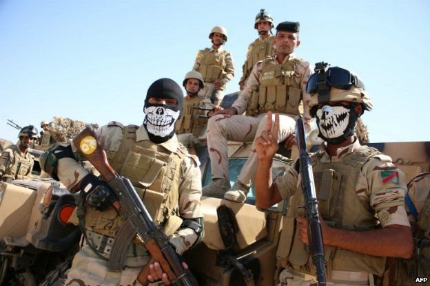Iraqi soldiers pose for a photograph during a military training exercise in Basra before being deployed to the north of Iraq - 14 September 2014