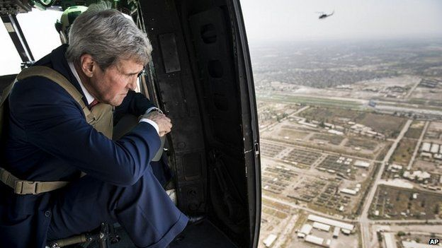 US Secretary of State John Kerry looks out from a helicopter over Baghdad, Iraq - 10 September 2014
