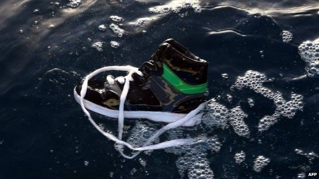A shoe belonging to an illegal immigrant floats on the water after a boat carrying illegal migrants sank off Libya