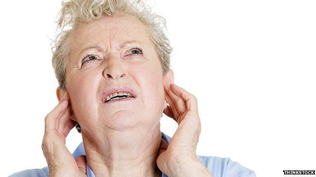 Woman puts fingers in her ears