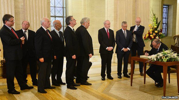 Assembly members queued to sign a book of condolence at Stormont