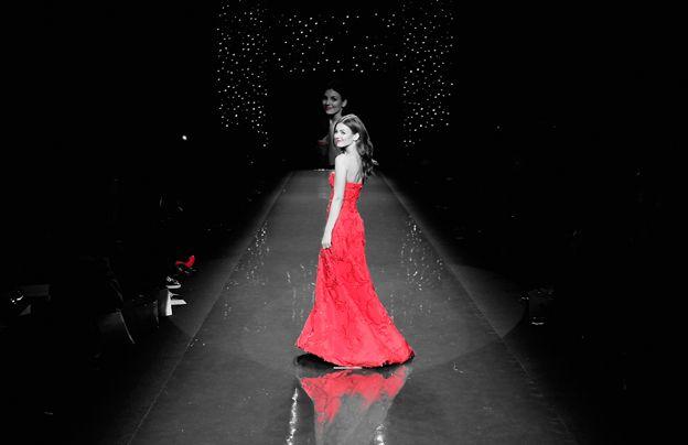 Model in red dress on catwalk