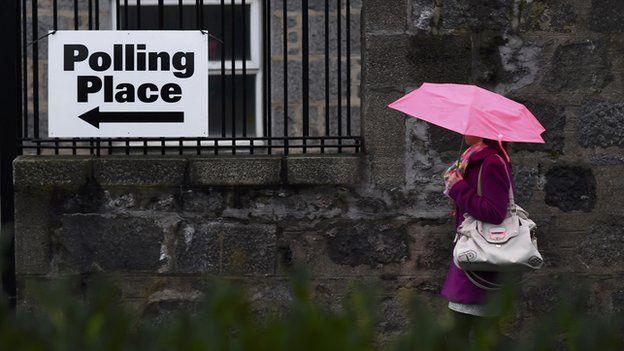 A voter arrives to cast her ballot at the Queen's Cross parish church in Aberdeen, Scotland