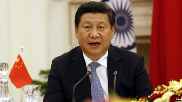 Chinese President Xi Jinping reads a statement after a meeting with Indian prime minster Narendra Modi at Hyderabad house in New Delhi, India, 18 September 2014
