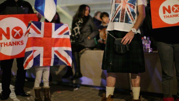 People wait outside the Scottish Parliament in Edinburgh