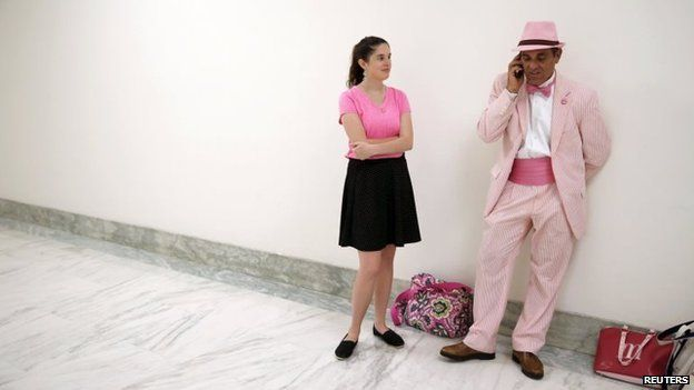 Code Pink members wait for entry into a House committee hearing (16 July 2014)