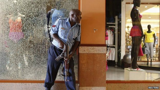 A police officer tries to secure an area inside the Westgate Shopping Centre where gunmen went on a shooting spree in Nairobi, 21 September 2013