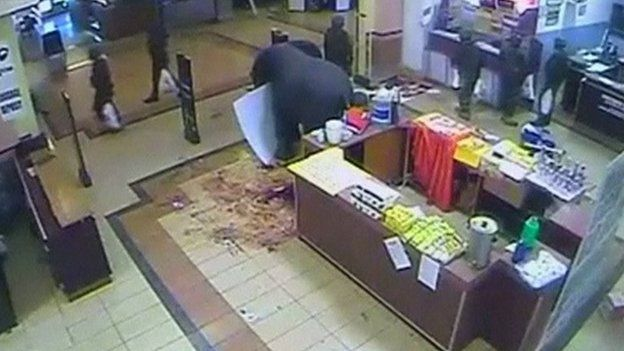 CCTV footage of Kenyan soldiers carrying plastic bags as they leave a supermarket in the Westgate shopping centre