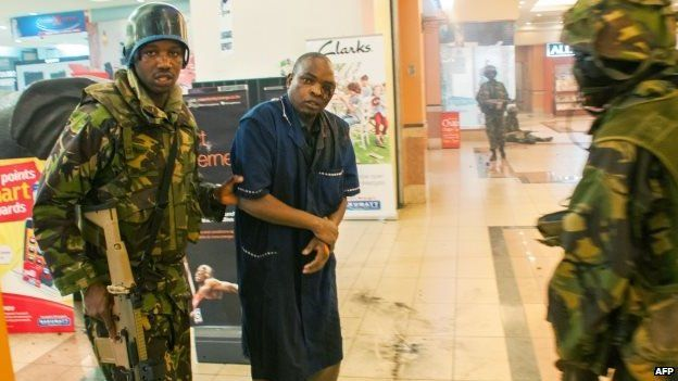 A wounded man is rescued by Kenyan troops at the Westgate mall on 21 September 2013 in Nairobi