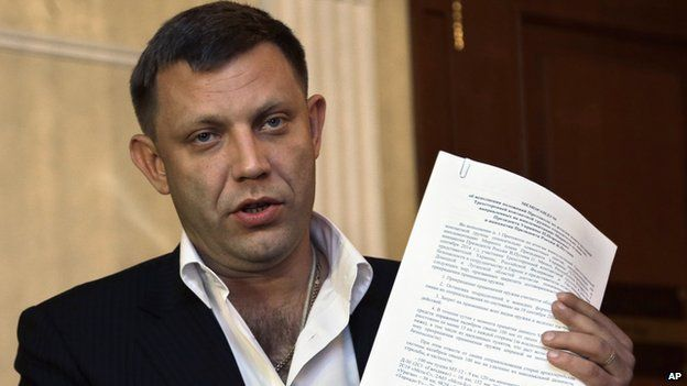 Alexander Zakharchenko, the leader of pro-Russian rebels in Donetsk, speaks to the media after peace talks in Ukraine in Minsk, Belarus, early Saturday, Sept. 20, 2014
