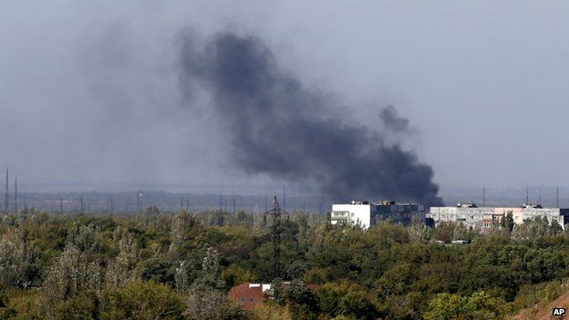 Smoke rises over the city of Donetsk. Photo: 20 September 2014