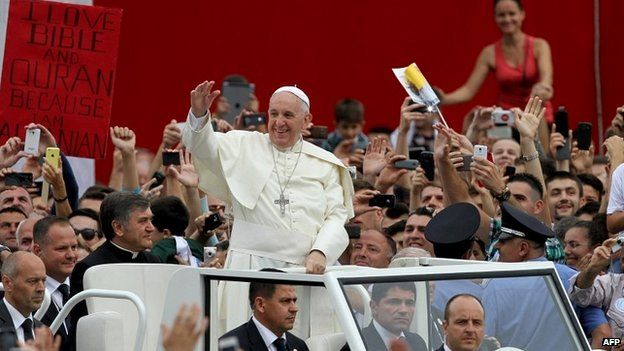 Pope Francis waves to crowds in Tirana, Albania - 21 September 2014