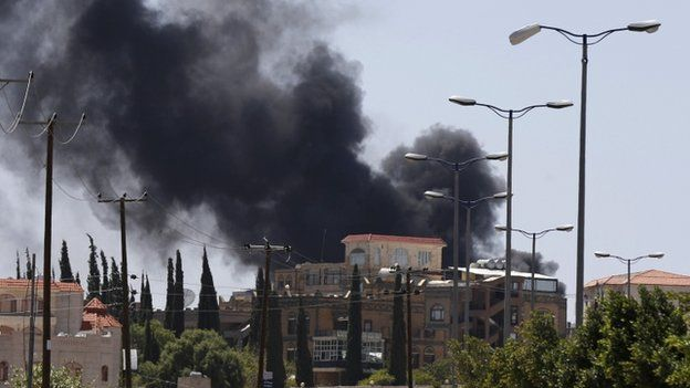 Smoke rises from an area where Shia Houthi rebels are fighting against government forces in Sanaa on 21 September 2014.