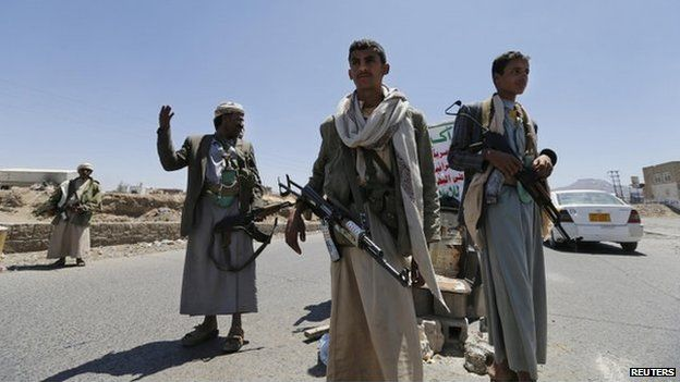 Shia Houthi rebels man a checkpoint they set up along a street in Sanaa on 21 September 2014.