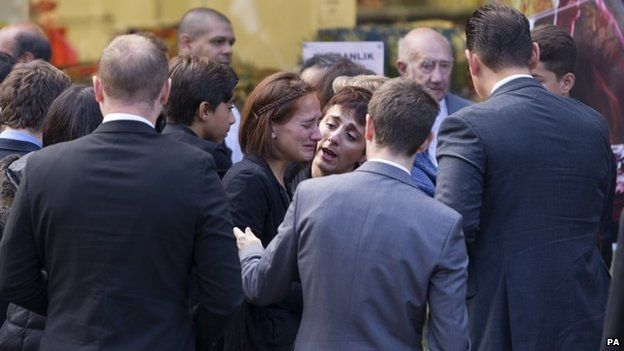 Mourners gather at funeral