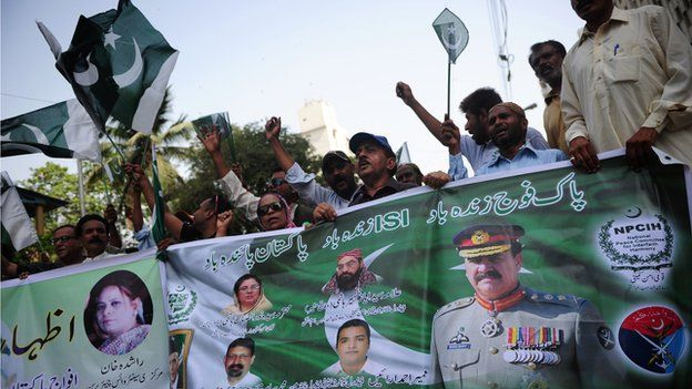 Pakistani civil society activists protest in support of the army as well the spy agency ISI in Karachi on May 4, 2014