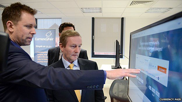 CurrencyFair chief executive Brett Meyers shows Irish Taoiseach Enda Kenny how the site works