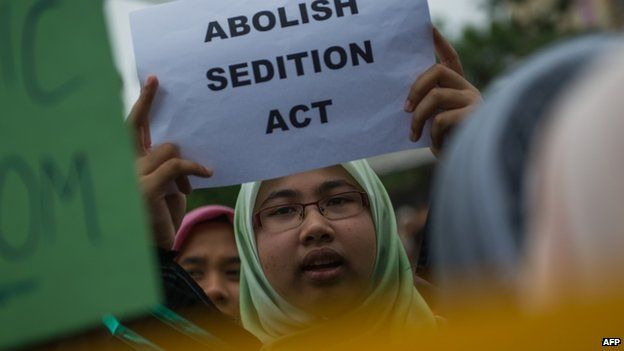 A student from the University of Malaya displays a placard during a rally against the sedition law at their main campus in Kuala Lumpur on 10 September 2014