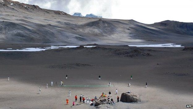 Cricketers play on 26 September 2014 in a crater of Mt Kilimanjaro in Tanzania