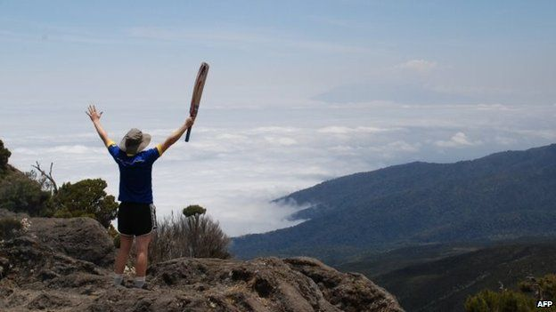 England women national cricket team vice-captain Heather Knight raises her arms on the second day of a trek up to Kilimanjaro, Tanzania - 21 September 2014
