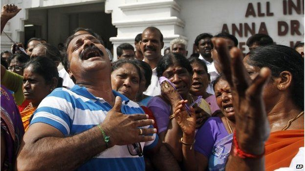 AIADMK party workers cry after a verdict was handed down to Jayaram Jayalalitha.