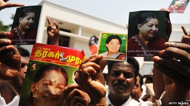 Supporters of All India Anna Dravida Munnetra Kazhagam (AIADMK) hold portraits of party leader J. Jayalalithaa in Chennai on 13 May 2011