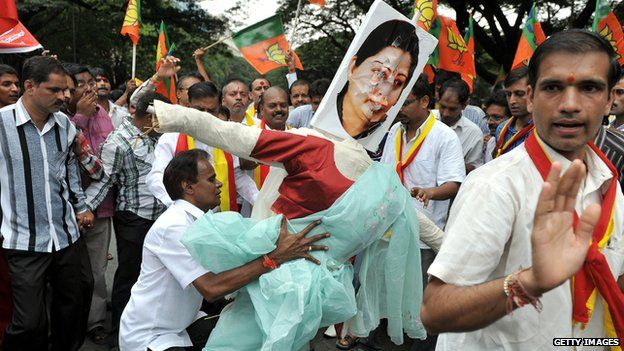 Indian activists from a pro-Kannada organisation carry an effigy of Tamil Nadu Chief Minister J. Jayalalithaa during a protest rally in Bangalore on 6 October 2012.