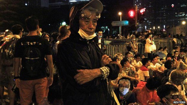 A 82-year-old resident joins thousands take parting in a pro-democracy rally outside the government headquarters in Hong Kong 27 September 2014.