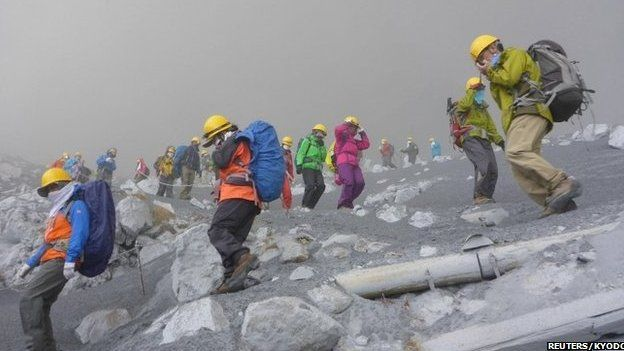 Climbers descending Mount Ontake through thick smoke