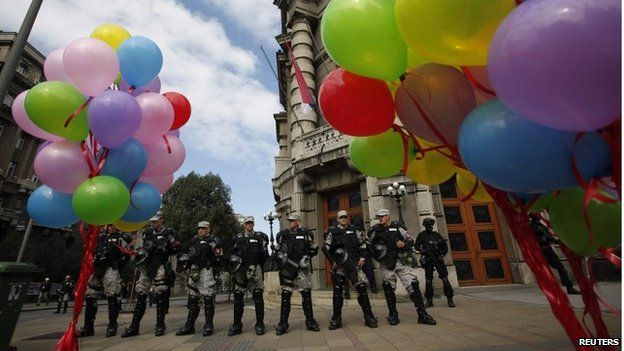 Riot police stand guard during the Gay Pride march in Belgrade.