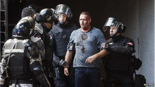 Riot police detain an anti gay activist