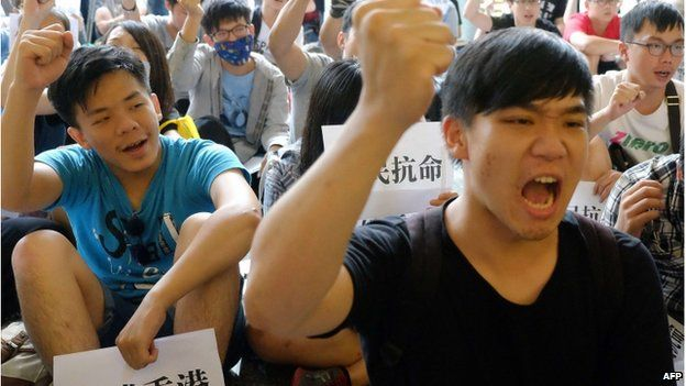 Pro-Taiwan independent students chant slogans during an anti-China demonstration at the lobby of the Hong Kong office in Taipei on 29 September 2014