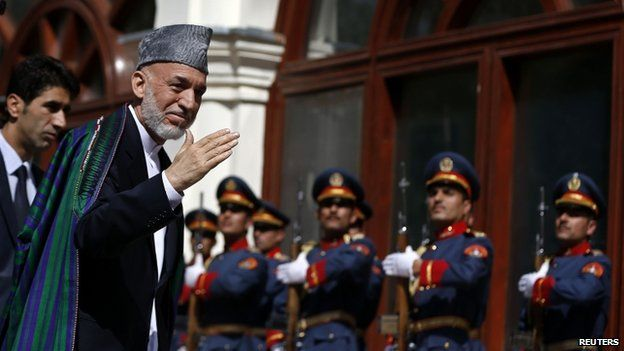 Former Afghanistan's president, Hamid Karzai, arrives for the inauguration of the new president in Kabul September 29, 2014.