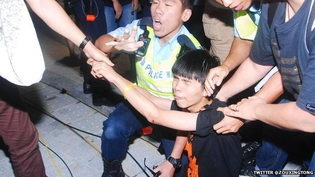 Joshua Wong being arrested