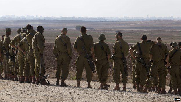 Israeli troops near the border between Israel and the Gaza Strip