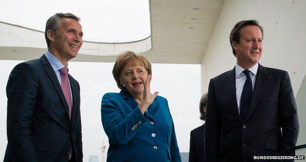 Jens Stoltenberg (left) with Angela Merkel and David Cameron in Berlin, 7 June 2012
