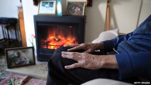 Elderly man by fire