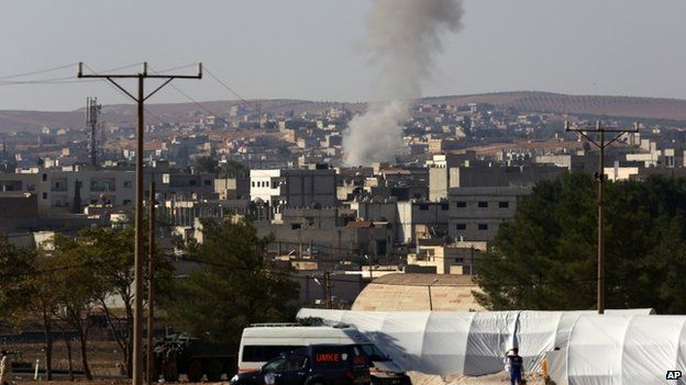 Smoke rises after a mortar attack on Kobane, from across the Turkish border - 5 October