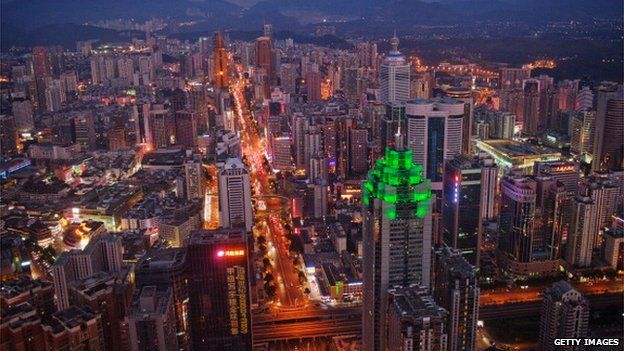 The Shenzhen skyline, including The Shenzhen World Financial Center, illuminated by green lights, stretches in to the distance on 28 November, 2010 in Shenzhen, China