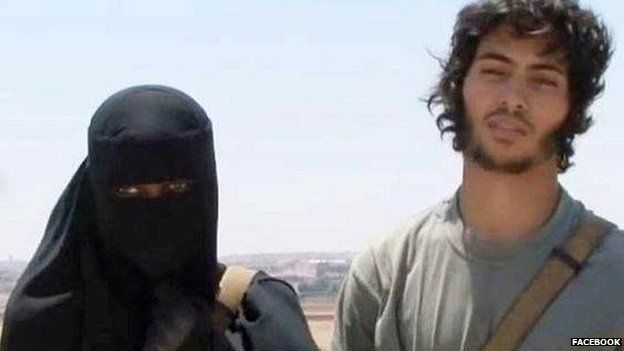 Khadijah Dare, in black niqab, and husband Abu Bakr pose for a Facebook photo in Syria