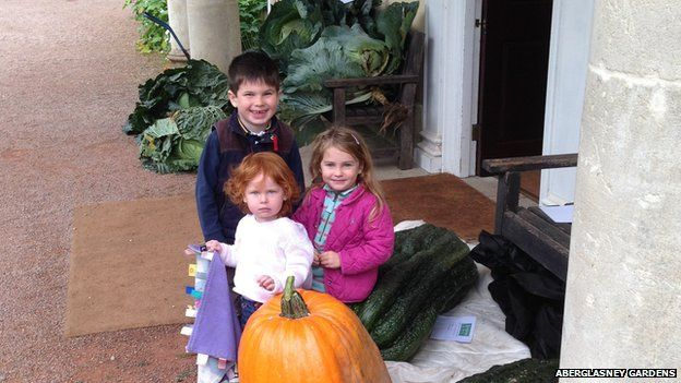 William, Molly and Elizabeth Edwards from Llandeilo with giant vegetables