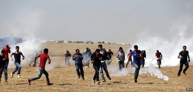 Turkish Gendarmerie use tear gas on Kurdish protestors during a demonstration against Islamic State militants near Sanliurfa, Turkey 7 October 2014
