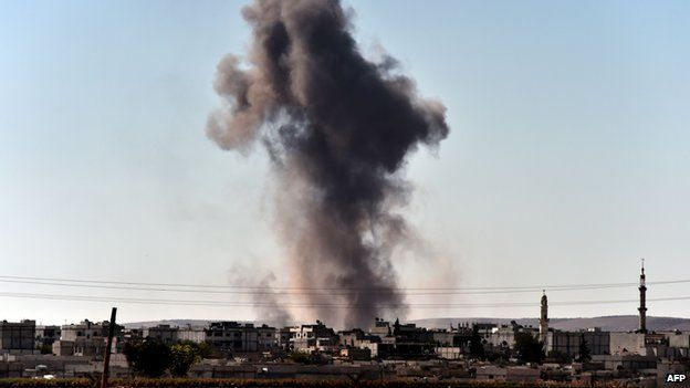 Smoke rises from the southwest of the Syrian town of Ain al-Arab, known as Kobane by the Kurds, following air strikes as seen from the Turkish-Syrian border in the southeastern town of Suruc, Sanliurfa province, on October 7, 2014