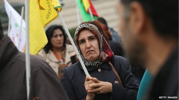 Demonstrators hold Kurdish flags at a rally by expatriate-Kurds in Berlin who were protesting against the ongoing violence by militias of the Islamic State (IS, also called ISIS or ISIL) in Iraq and Syria on October 7, 2014