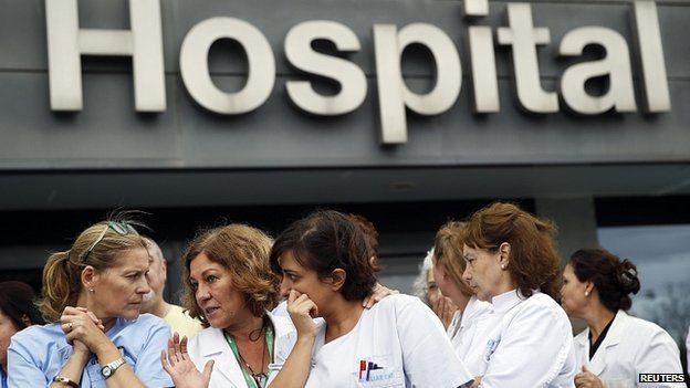 Hospital staff attend a protest outside La Paz Hospital in Madrid, Spain. 7 Oct 2014