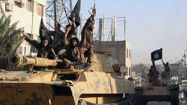 Islamic State fighters parade through Syrian city of Raqqa on tanks (30 June 2014)
