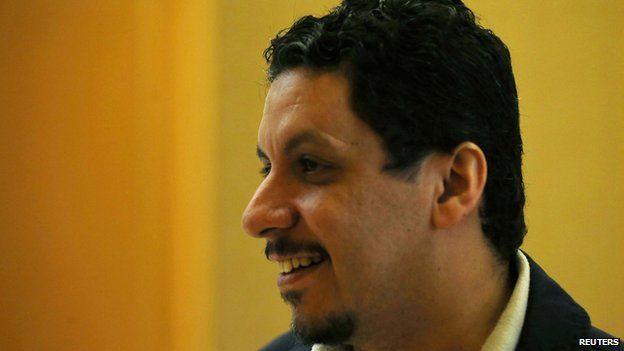 Yemeni politician Ahmed Awad bin Mubarak speaks to journalists as he enters a hotel in Sanaa September 27, 2014