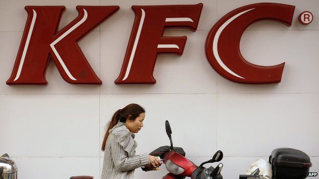 A woman in China outside a KFC store