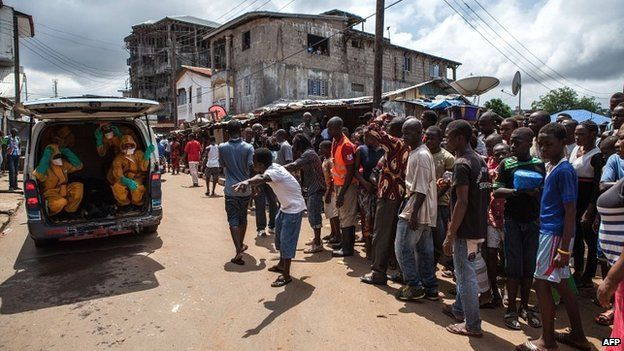 Volunteers arrive to pick up bodies of Ebola victims in Freetown, Sierra Leone - 8 October 2014